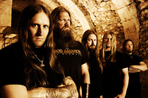 Metal wallpaper probably with a street and a portcullis titled Amon Amarth