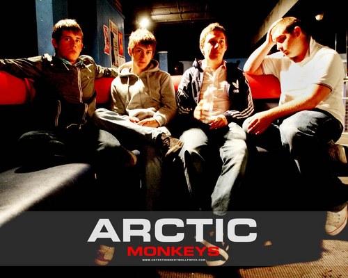 Arctic Monkeys karatasi la kupamba ukuta with a business suit called Arctic Monkeys