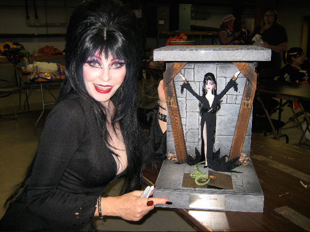 Elvira with the Elvira doll
