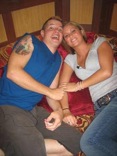 Couple using bondage and vibrator