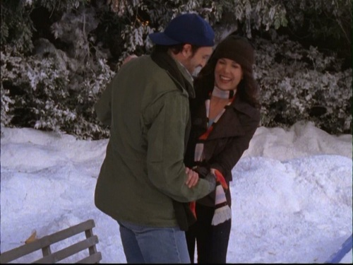 TV Couples achtergrond with a snowbank, an igloo, and rodelen called Luke & Lorelai (Gilmore Girls)