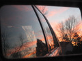 Sunset in car mirror - photography photo