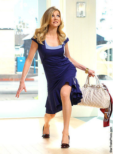 Sarah Chalke wallpaper probably containing bare legs, hosiery, and a playsuit called Sarah