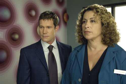 Nip/Tuck wallpaper with a business suit and a suit called Sean & Liz