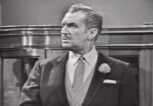 Vincent Price वॉलपेपर with a business suit titled The Red Skeleton दिखाना
