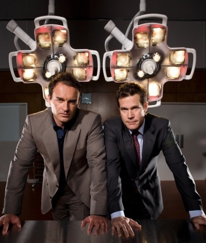 Nip/Tuck wallpaper containing a business suit and a suit called nip tuck