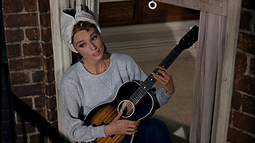 http://images1.fanpop.com/images/image_uploads/screencap-breakfast-at-tiffanys-888950_852_480.jpg