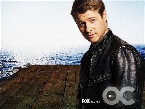 Television wallpaper possibly containing a well dressed person, an outerwear, and a box coat titled The OC