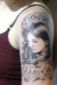 Buffy's fan tattoo