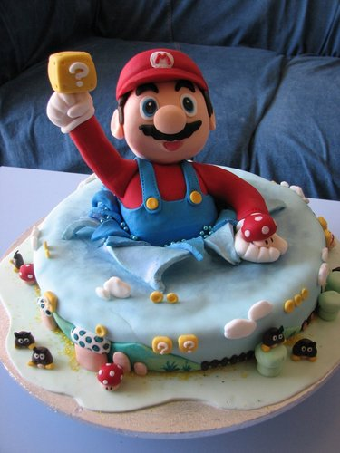 Nintendo wallpaper possibly with a cupcake, a tutti frutti, and pancakes entitled Mario cake