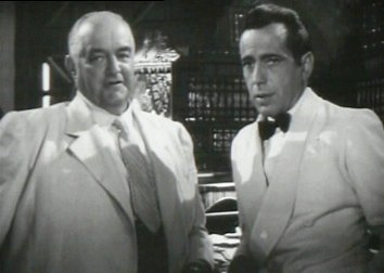 Casablanca fond d'écran with a business suit titled Signor Ferrari & Rick