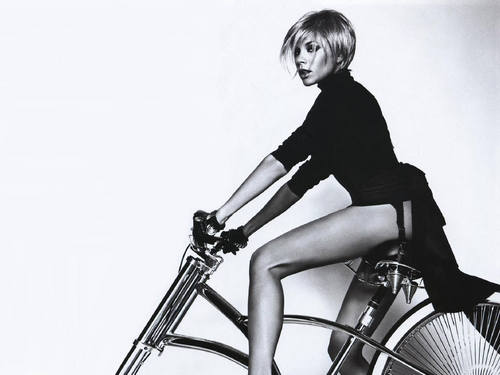 Victoria Beckham wallpaper containing a velocipede entitled Victoria
