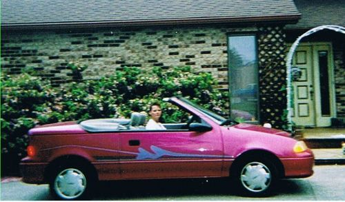 Chevrolet wallpaper possibly with a convertible titled chevy geo/40-50 mpg/ engine 1.0l l3 fi suzuki