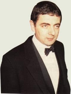 Rowan Atkinson wolpeyper probably with a business suit entitled Mr.Bean