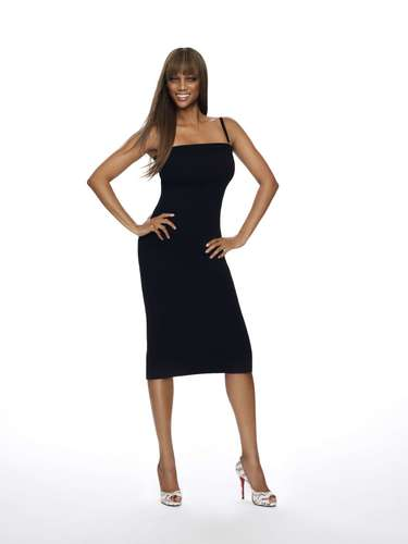 Tyra Banks wolpeyper probably with a kaktel dress, a chemise, and a chemise called Tyra