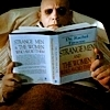 Addams Family photo with a newspaper entitled Uncle Fester