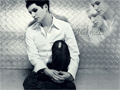 Brian Molko wallpaper containing a chainlink fence and a hip boot titled Brian