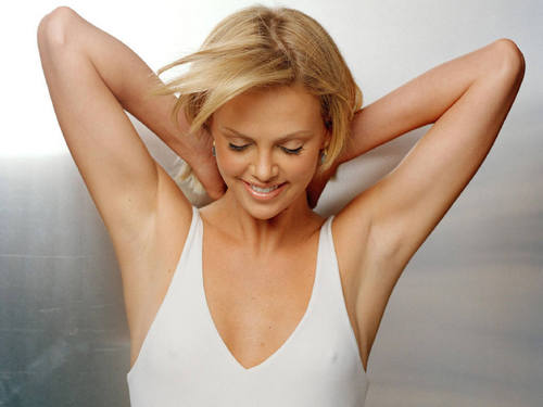 Charlize Theron wallpaper possibly containing attractiveness, a leotard, and a maillot titled Charlize