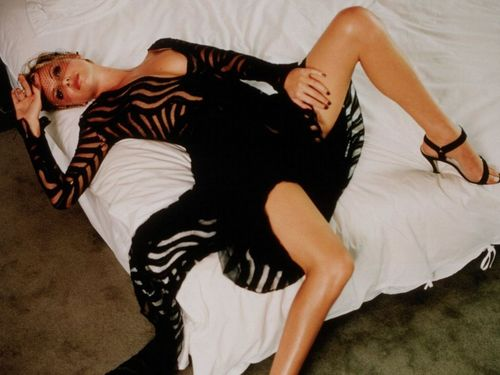 Charlize Theron wallpaper probably with bare legs, a cocktail dress, and tights entitled Charlize