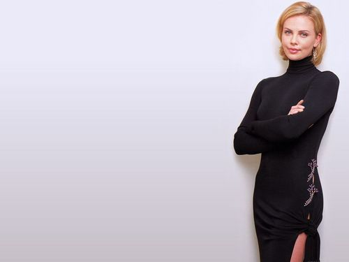 Charlize Theron wallpaper probably with a well dressed person and an outerwear titled Charlize