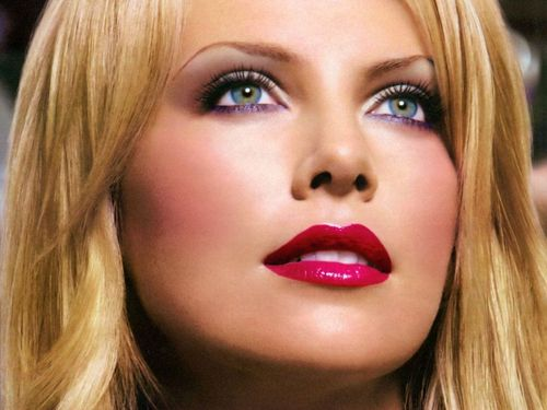 Charlize Theron wallpaper probably with a portrait entitled Charlize