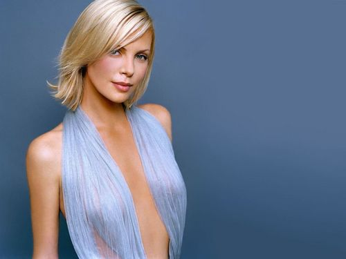 Charlize Theron karatasi la kupamba ukuta probably containing a portrait titled Charlize