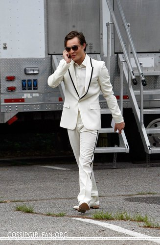 Ed Westwick wolpeyper with a business suit, a well dressed person, and a suit entitled Ed filming GG