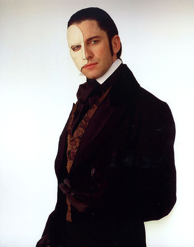 The Phantom Of The Opera wallpaper containing a well dressed person called POTO