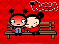 Pucca and Garu sitting on a bank