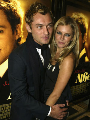 Celebrity Couples wallpaper containing a business suit, a suit, and a dress suit called sienna miller & jude law