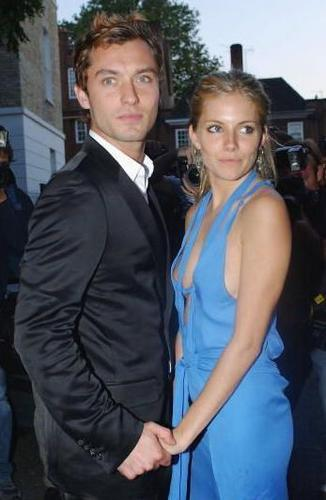Celebrity Couples দেওয়ালপত্র with a business suit and a suit titled sienna miller & jude law