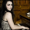 Amy Lee photo possibly with a pianist, a chemise, and a bustier called Amy Lee