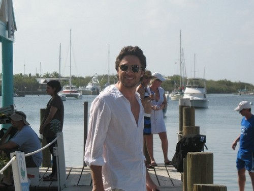 Zach Braff Hintergrund with a pontoon, a car ferry, and a strand house entitled Zach in the bahama's