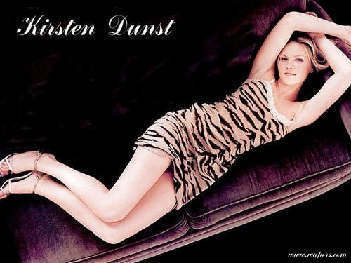 Kirsten Dunst wallpaper probably containing bare legs, a sign, and a fedora called LAY WITH ME