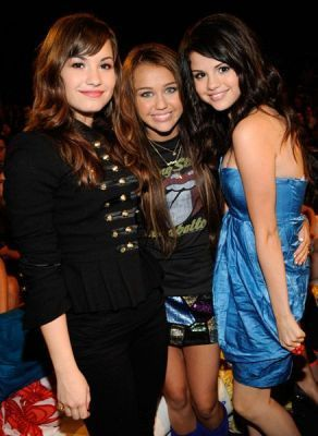 Miley Cyrus vs. Selena Gomez wallpaper entitled Miley,Selena,Demi