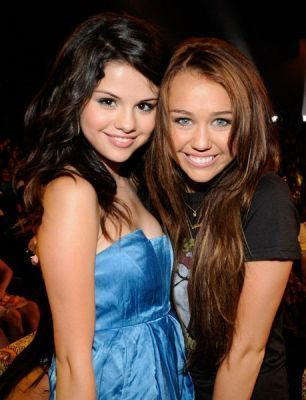selena gomez breast size. miley cyrus or selena gomez?