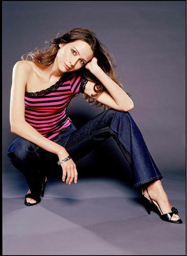 Amy Acker kertas dinding with a well dressed person, a hip boot, and tights titled Amy