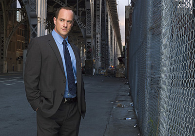 Law and Order SVU wallpaper with a chainlink fence and a business suit titled Det. Elliot Stabler