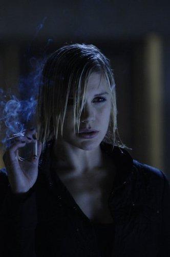 Katee as Sarah Corvus
