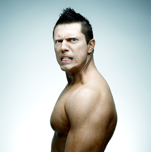Professional Wrestling Hintergrund containing a six pack, a hunk, and skin called The Miz