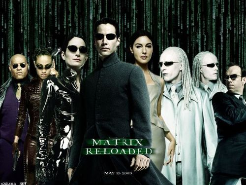cine fondo de pantalla probably containing a well dressed person, a business suit, and a box capa titled the matrix