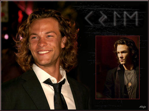 Kyle Schmid wallpaper with a business suit titled 24