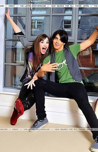 Jemi achtergrond probably with bare legs, a well dressed person, and an outerwear called Camp Rock Photoshoot
