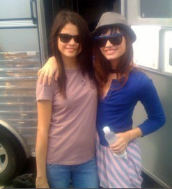 Demi and Selena on set