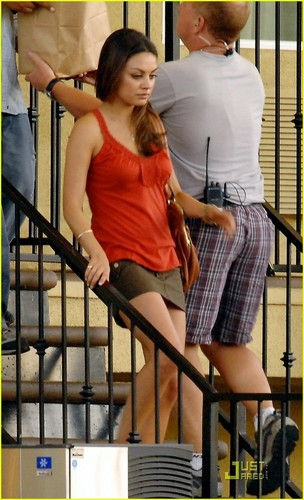 Mila Kunis Hintergrund probably containing a bannister entitled Just Mila