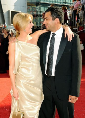 Kal Penn and Jennifer Morrison at the 60th Primetime Emmy Awards