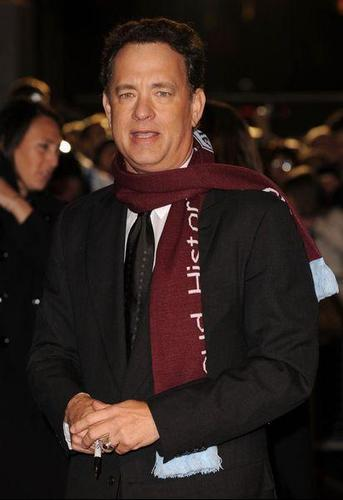 Tom Hanks wallpaper possibly with an outerwear, a business suit, and a well dressed person titled Tom