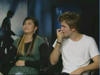 look at katie leung's expression!! XD