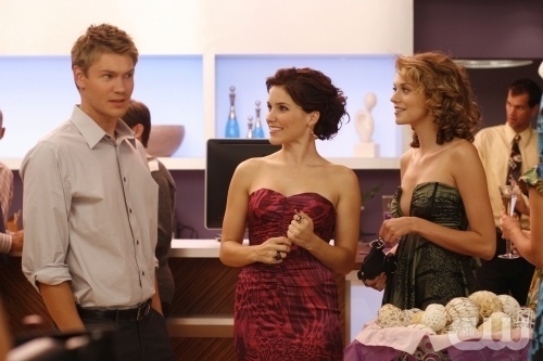 Brucas and Jamie wolpeyper with a bridesmaid entitled BLJ