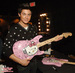 zac efron with a hello kitty guitar
